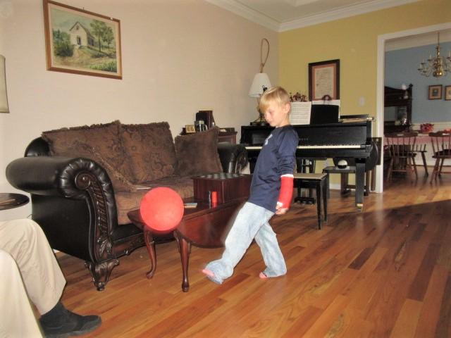 110618 Logan plays balloon with his feet.JPG