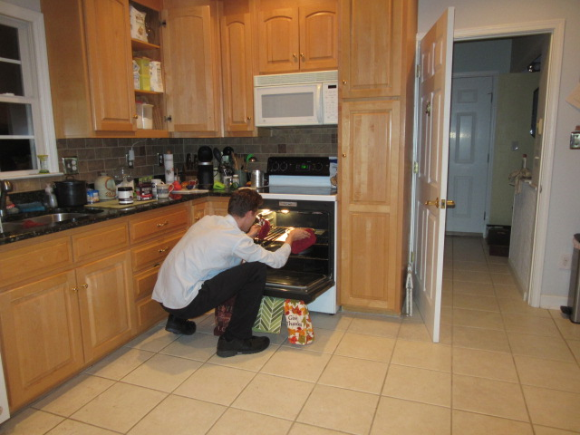 112018 Nate checks cake in oven.JPG