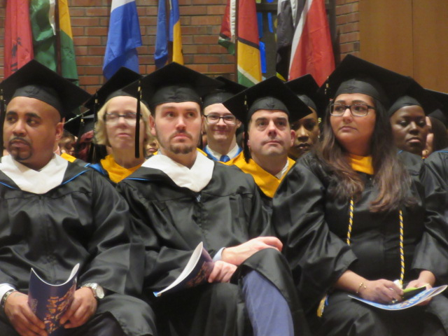 121618 David graduates  (2) among classmates.JPG