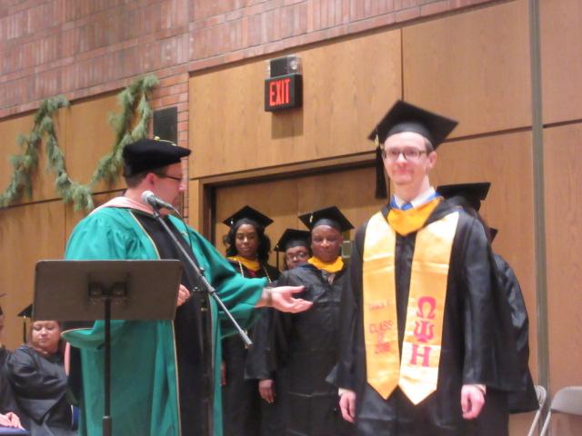 121618 David graduates  (5) Dr J announces names.JPG