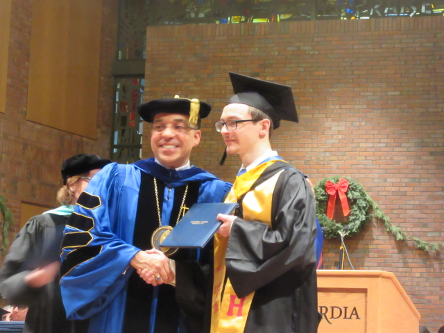 121618 David graduates  (7) Dr Nunes poses with David.JPG
