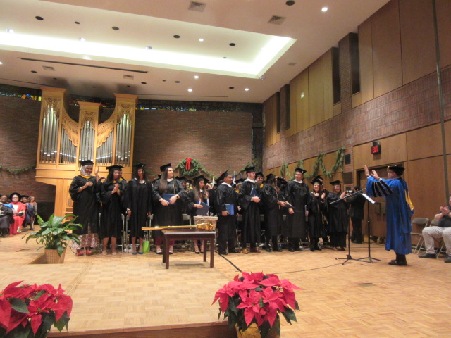 121618 David graduates  (9) Changing tassels.JPG