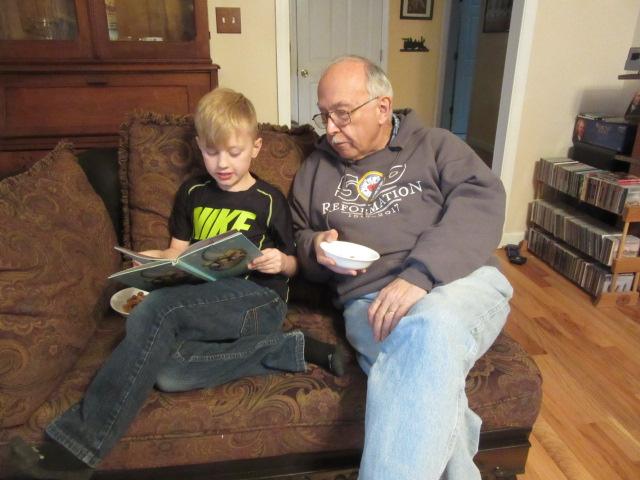 030719 Logan reads to John.JPG