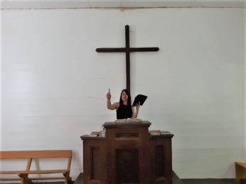 052719 Rose pretending to preach at Cataloochee chapel